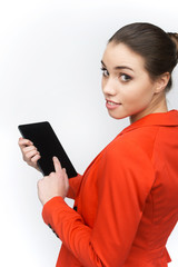 Young woman using touch pad on white background.
