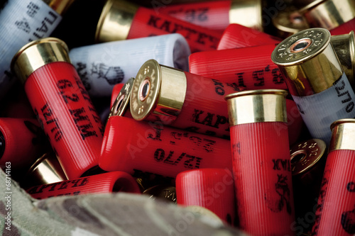 Fotobehang Beijing Rebels shotgun cartridges in multicam cap