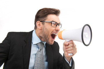 portrait of young handsome man shouting using megaphone.