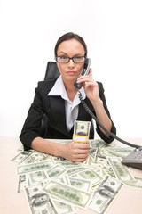 Closeup of businesswoman looking at camera and holding money