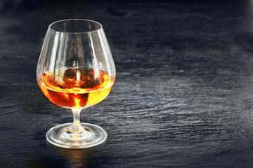 Elegant snifter with glowing golden cognac
