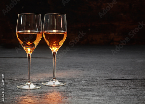 Plexiglas Boord Two wine glasses standing on stone surface