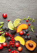 Fresh fruit and herbs on a slate background