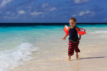 child running on sand beach