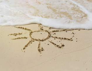Drawing of sun in the sand on exotic beach