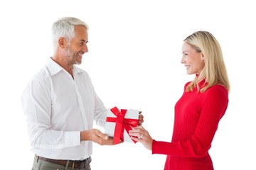Smiling couple holding a gift