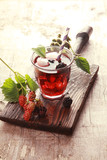 Glass of fruit juice with fresh blackberries