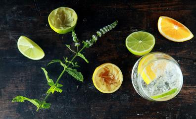 Fresh Lemons and Lemon Water on Wooden Table