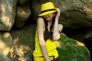 Smiling girl with two pigtails in a yellow hat