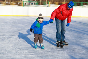 father and little son skating
