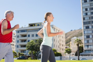 Fit mature couple jogging together