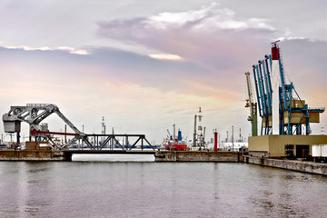 Cargo sea port. Sea cargo cranes. Bridge and marine gateway.