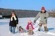 Happy family winter fun outdoors, parents with kids playing