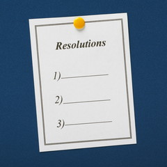 Resolutions List pinned to a blue notice board