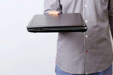 Closeup portrait of a male hand holding laptop