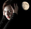 young woman portrait on dark background with moon