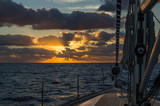 Sailing boat at sunrise in Atlantic ocean