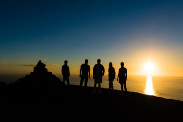 Group of travellers at sunset