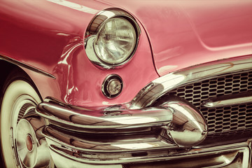 Retro styled image of a front of a classic car © DutchScenery