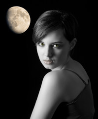 young woman with nice face on dark background with moon