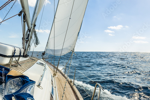 Fotografiet Yacht sail in the Atlantic ocean at sunny day cruise