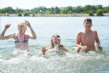 Portrait of happy children in lake