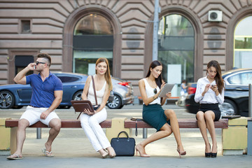 Business people sitting on a bench