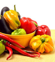 Sweet pepper, aubergine, chilli pepper in the plate