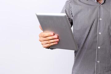 Closeup portrait of a man holding tablet computer