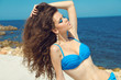 Summer beauty girl portrait with long wavy hair & makeup on the