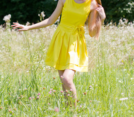 Girl on the flower meadow