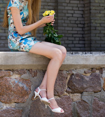 Girl holding bouquet of yellow roses