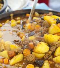 Stir Traditional stew,  farm-style