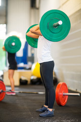 Female Athlete Picking Barbell