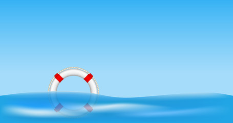 White life buoy floating on water