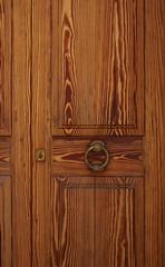 Holztür mit Türklopfer aus Messing