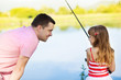 Happy father and daughter fishing