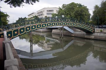 Small bridge over a canal in Bangkok, Thailand