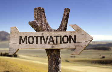 Motivation wooden sign with a desert background