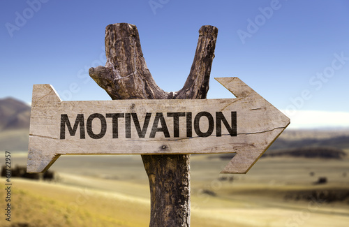 Motivation wooden sign with a desert background Photo by gustavofrazao