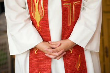 Hands of female priest