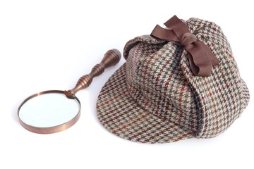Deerhunter or Sherlock Holmes cap and vintage magnifying glass