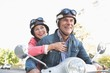 Happy senior couple riding a moped - 68724126