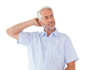 Thinking man posing with hand behind head
