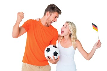 Excited football fan couple cheering