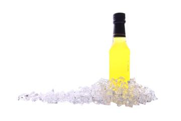 Liquor bottle and ice cracked on white background.