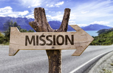 Mission wooden sign with a highway on background