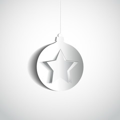 Christmas ball and star made from papercut on white background,