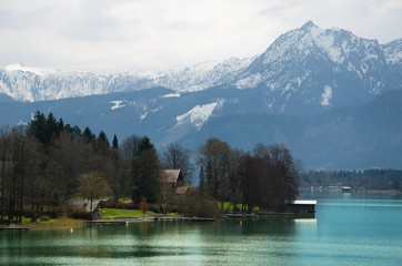 Village with Alps range and lake background