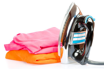Electric iron and colorful clothes isolated on white